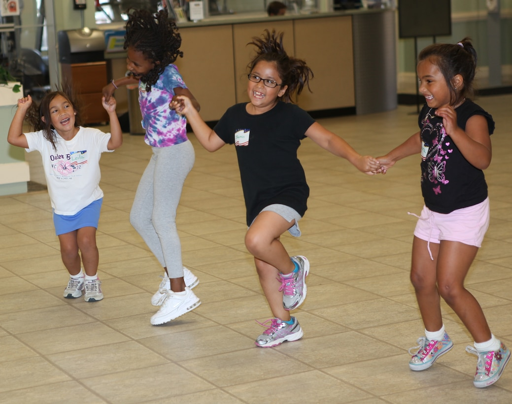 Children jump and dance while participating in Zumbatomic at the Midway Park Community Center , at the housing community aboard Marine Corps Base Camp Lejeune. Zumbatomic gave the children an opportunity to have fun while working out and learning about other cultures.