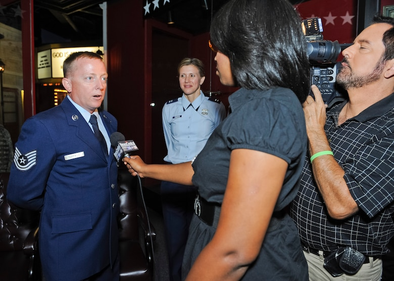 Tech. Sgt. Barry Duffield, 116th Civil Engineering Squadron explosive ordnance technician, is interviewed by Fox 24 News after a ceremony where Duffield was awarded the Bronze Star Medal at the Museum of Aviation, Robins Air Force Base, Ga., June 18, 2012.  Duffield received the medal, his 2nd, for his achievements while serving as an explosive ordnance disposal team leader in Afghanistan during a six-month period from 2011 to 2012.  Capt. Pamela Stauffer, 116th Air Control Wing public affairs officer, looks on during the interview.  (National Guard photo by Master Sgt. Roger Parsons/Released)