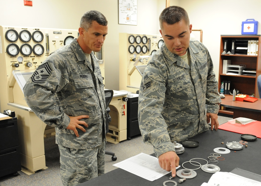 Staff Sgt. Evan Schuelke, 9th Physiological Support Squadron life support technician, explains parts of the U-2 Dragon Lady pressure suit to Chief Masters Sgt. Richard Parsons, command chief of Air Combat Command, June 21, 2012 at Beale Air Force Base, Calif. Parsons was introduced to the U-2 mission with a viewing of a full pressure suit and a chase car orientation. (U.S. Air Force photo by Mr. John Schwab)