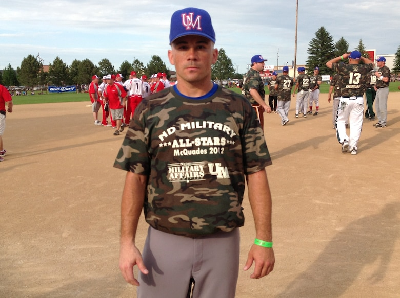 Bismarck, N.D. -- The first ever McQuade's North Dakota Military All Stars Softball Team played Team USA Features on June 22 in the first exhibition game of the Sam McQuade Softball Tournament. Staff Sgt. Louis Kane, 705th Munitions Squadron, represents Team Minot. The Sam McQuade Sr./Budweiser Charity Softball Tournament is the US' largest non-profit, one weekend slowpitch softball tournament that brings together players, families and fans from all over the country. (Courtesy photo)