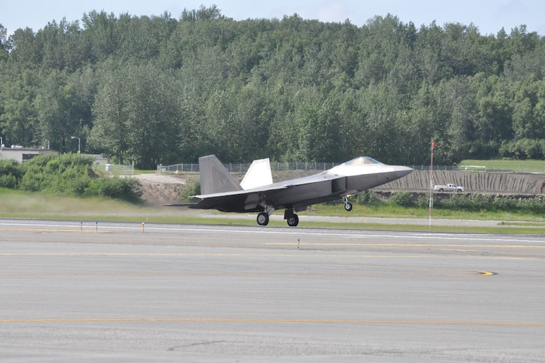 """JOINT BASE ELMENDORF-RICHARDSON, Alaska --- 525th Fighter Squadron """"Bulldogs"""" prepare to land F-22s at JBER June 20, 2012 after flying sorties in Red Flag-Alaska. Red Flag-Alaska 12-2, June 6-22, was the first multi-national RF-A in which F-22s cleared the skies of simulated enemies for partner nations. (U.S. Air Force photo/Luke Waack)"""