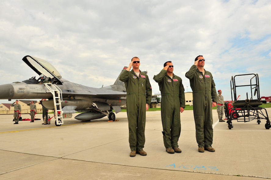 SPANGDAHLEM AIR BASE, Germany – Airmen from the 52nd Fighter Wing salute during the playing of the German and American national anthems upon arrival of Brig. Gen. Chris Weggeman, 52nd Fighter Wing commander, here June 21. Weggeman commanded the 52nd FW for two years. (U.S. Air Force photo by Airman 1st Class Dillon Davis/Released)