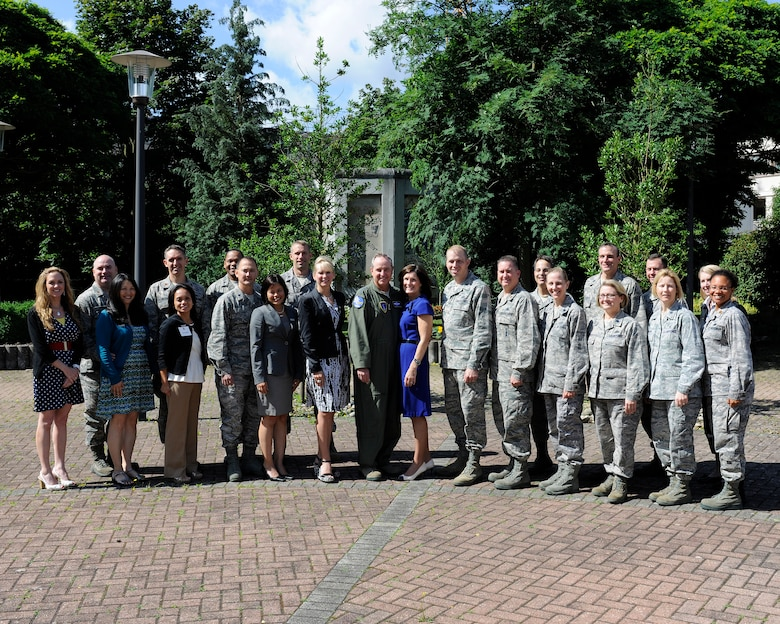 Gen. Mark A. Welsh III, U.S. Air Forces in Europe commander, and his wife Betty, pose with attendees of the USAFE Squadron Commanders' and Spouses' seminar held June 18 to 22 at Ramstein Air Base. (U.S. Air Force photo by Senior Airman Christopher Willis/released)