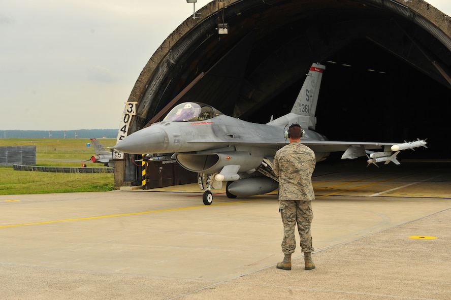 SPANGDAHLEM AIR BASE, Germany – Brig. Gen. Chris Weggeman, 52nd Fighter Wing commander, taxis an F-16 Fighting Falcon out of an aircraft shelter before his final flight here June 21. Weggeman commanded the 52nd FW for two years. (U.S. Air Force photo by Airman 1st Class Dillon Davis/Released)
