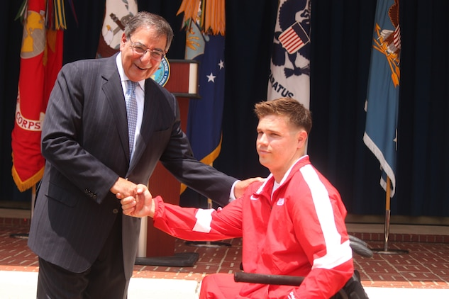Defense Secretary Leon E. Panetta congratulates Cpl. Chris Montgomery All-Marine Warrior Games athlete at the 2012 Warrior Games recognition ceremony held in the Pentagon courtyard Monday. The ceremony celebrates the remarkable achievements and resilience of over 200 wounded, ill and injured service members who competed in the 2012 Warrior Games in Colorado Springs, Colo., April 30 to May 5.