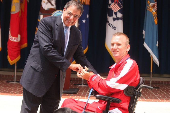 Defense Secretary Leon E. Panetta congratulates Marine veteran Lance Cpl. Lance Weir All-Marine Warrior Games athlete at the 2012 Warrior Games recognition ceremony held in the Pentagon courtyard Monday. The ceremony celebrates the remarkable achievements and resilience of over 200 wounded, ill and injured service members who competed in the 2012 Warrior Games in Colorado Springs, Colo., April 30 to May 5.