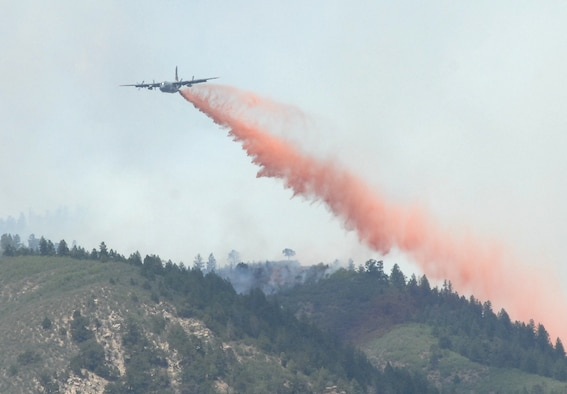 COLORADO SPRINGS, Colo. - A Modular Airborne Fire Fighting System-equipped C-130 drops retardant on a section of the Waldo Canyon fire near Colorado Springs, Colo. June 26. Four MAFFS aircraft from the 302nd and 153rd Airlift Wings are supporting civil authorities as they combat the fire, which has burned since June 23. (U.S. Air Force photo by Tech. Sgt. Thomas J. Doscher)