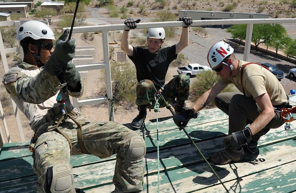 Staff Sgt. Richard Dunn, pararescueman with the 306th Rescue Squadron provided instruction on proper repelling techniques to Civil Air Patrol Cadets at the Pima County Rescue Training Center as part of the Advanced Pararescue Orientation Couse, a 10 day course that introduces CAP cadets to the operational PJ career field. (U.S. Air Force photo/ Master Sgt. Luke Johnson)