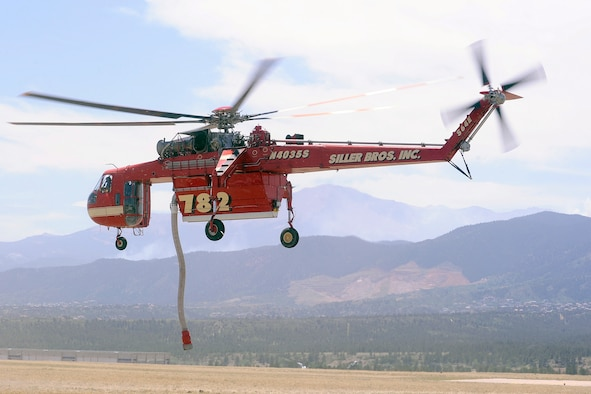 A Siller Brothers firefighting helicopter takes off from the Air Force Academy airfield to fight the Waldo Canyon fire June 25, 2012. The Academy canceled its normal flying operations June 23 to facilitate helicopter operations. (U.S. Air Force photo/Mike Kaplan)