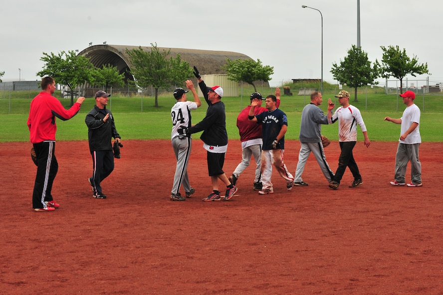 SPANGDAHLEM AIR BASE, Germany – Team members from the Geilenkirchen B Team and LMS Team congratulate one another to show sportsmanship after the first Top IV sponsored Ammo Softball Tournament championship game on Field 2 here June 24. The tournament consisted of 9 teams and spanned three days. (U.S. Air Force photo by Airman 1st Class Dillon Davis/Released)
