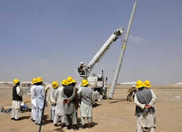 AFGHANISTAN — Afghan electrical power technicians receive on-the-job training from U.S. Army Corps of Engineers Soldiers that will enable them to safely sink the power poles and replace 110 kV lines throughout Kandahar and Helmand provinces in southern Afghanistan.