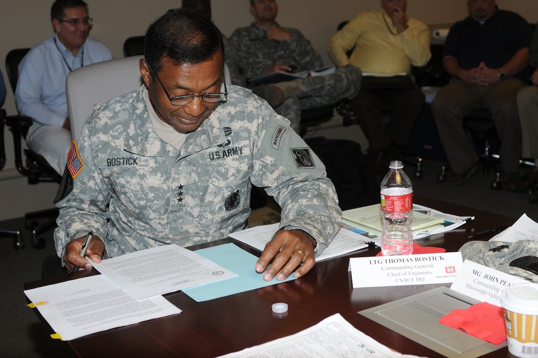 """LOUISIANA — Lt. Gen. Thomas Bostick, Commanding General of the U.S. Army Corps of Engineers, signed the """"Louisiana Coastal Area Barataria Basin Barrier Shoreline Restoration"""" report June 22, 2012 on top of the Inner Harbor Navigation Canal Surge Barrier. Col. Edward Fleming, U.S. Army Corps of Engineers New Orleans District commander, highlighted the united front federal, state and local agencies are taking in support of the Hurricane and Storm Damage Risk Reduction System building built here. The HSDRRS system is referred to as the best the area has ever had regarding storm risk reduction. On hand for the ceremony was U.S. Sen. David Vitter."""