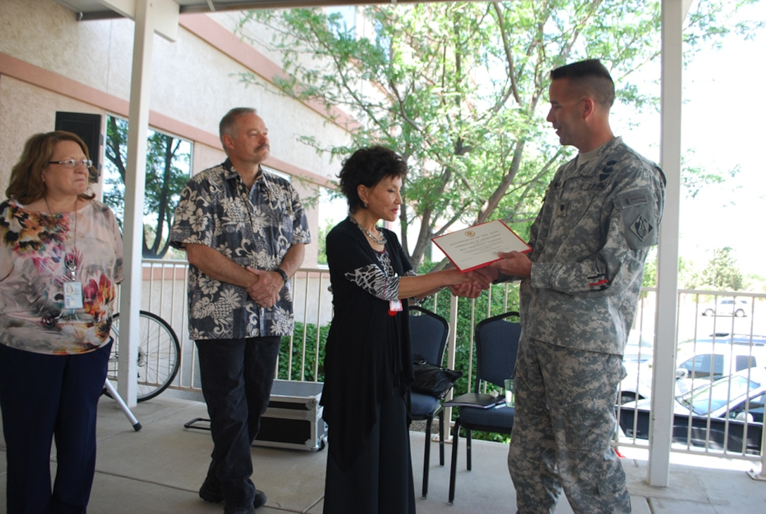 "Sue ""Hwa Soon"" Thorson recieves a certificate of appreciation for delivering the keynote speech on May 24."