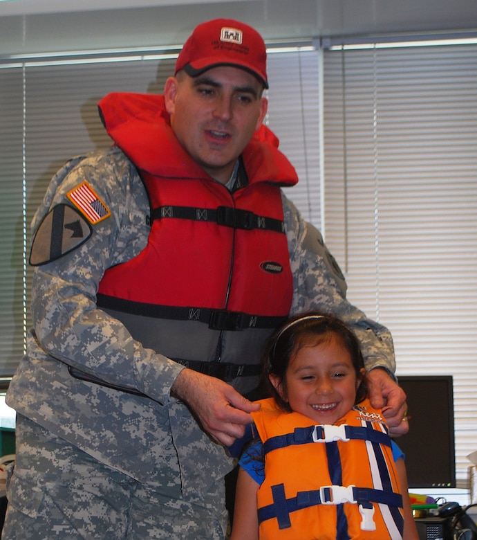 Lt. Col. Richard Collins and a student demonstrate life jacket safety.