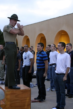 Sgt. Cory Marcus, senior drill instructor, Receiving Company, Support Battalion, explains to recruits how to stand with their belongings, June 11 aboard Marine Corps Recruit Depot San Diego. After learning how to stand, recruits were read the Uniform Code of Military Justice, informing each recruit about the legal aspects they must adhere to.