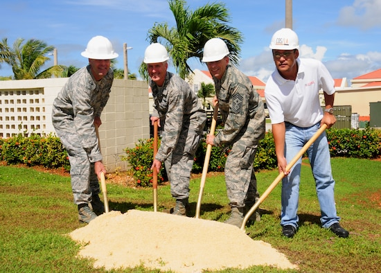 ANDERSEN AIR FORCE BASE, Guam-- Leadership from Team Andersen and current contractors break ground for a new warehouse behind the 36th Medical Group June 22. The new warehouse will soon be constructed to store the 36 MDG's medical war reserve materials in one location. This new warehouse will add an additional 4,000 square feet of climate-controlled space, thus allowing the 36 MDG to consolidate all of its WRM assets in one location.(A logo was removed from a helmet to refrain from