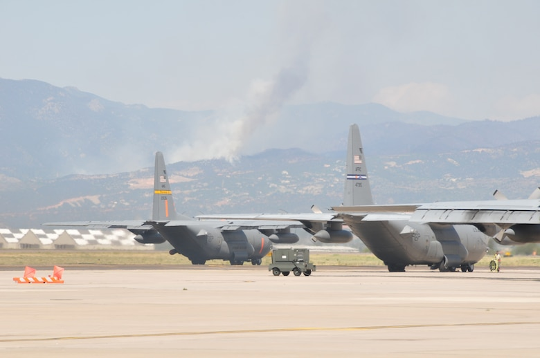 MAFFS equipped C-130's from the 153rd Air Expeditionary Group prepare to take off from Peterson Air Force Base, Colo. June 26, 2012. Crews made 20 drops delivering 52,000 gallons of retardant in an effort to suppress the Waldo Canyon fire. (U.S. Air Force photo/Airman 1st Nichole Grady)