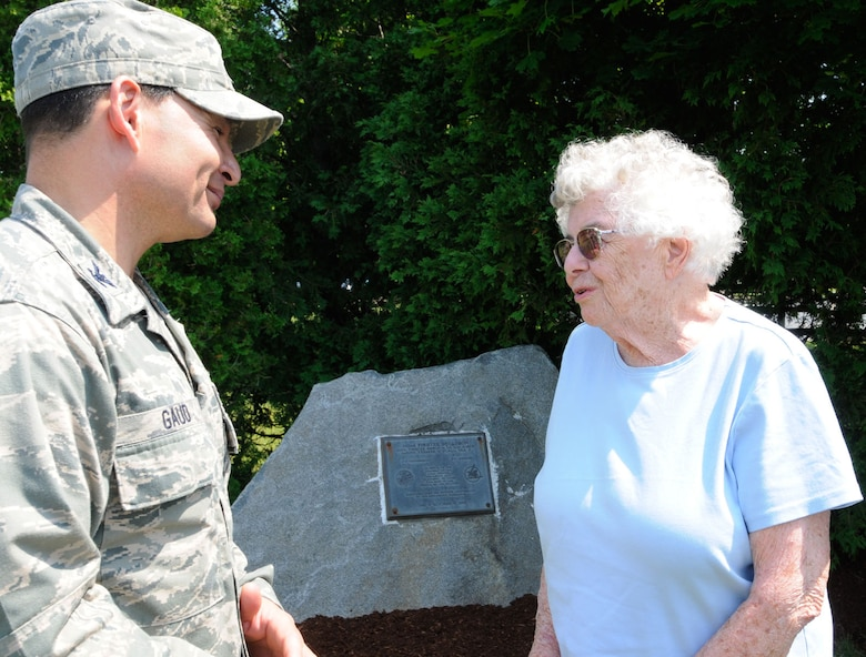HANSCOM AIR FORCE BASE, Mass. – Col. Juan Gaud, 66th Air Base Group deputy commander, meets with Jane Sutcliffe in front of the 342nd Fighter Squadron plaque in Memorial Park June 22. Sutcliffe, along with six immediate family members, visited the memorial in honor of her late husband Robert, a World War II ace who served with the squadron that was stationed at Hanscom from January to April 1943. (U.S. Air Force photo by Linda LaBonte Britt)