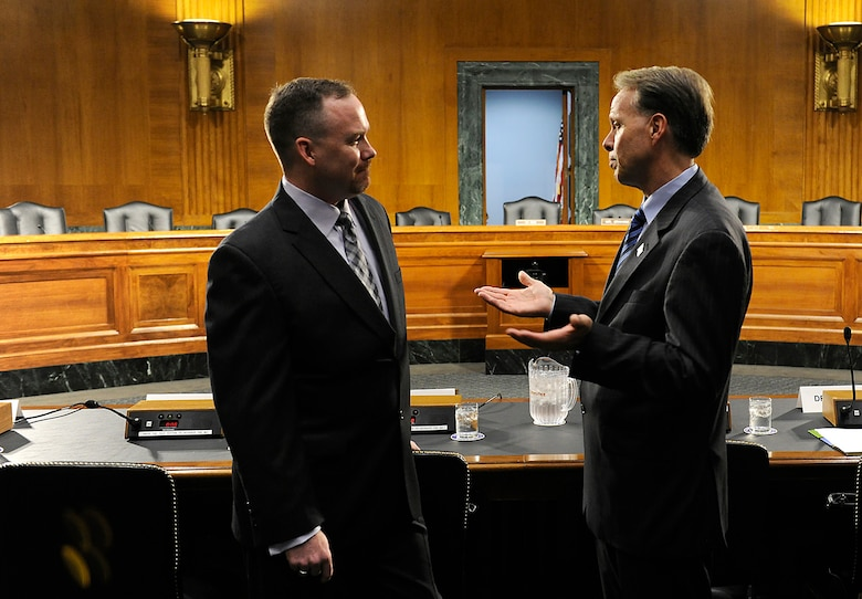 Jeremy Hilton and Charles Milam talk prior to a hearing in front of the U.S. Senate Armed Services Subcommittee on Personnel in Washington, D.C., June 21, 2012. Hilton provided testimony on Department of Defense programs and policies in support of military families with special needs. Hilton is the Military Spouse of the Year for 2012 and Milam is the principal director for military community and family policy (U.S. Air Force photo/Scott M. Ash)