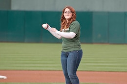 OAKLAND, Calif. — Allie Pearce throws out the ceremonial first pitch on her 16th birthday before the Oakland Athletics game against the San Francisco Giants at O.co Coliseum here, June 22, 2012.