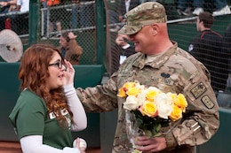 OAKLAND, Calif. — Allie Pearce wipes away tears as she talks with her dad, Army Specialist Scott Pearce, on her 16th birthday before the Oakland Athletics game against the San Francisco Giants at O.co Coliseum here, June 22, 2012.