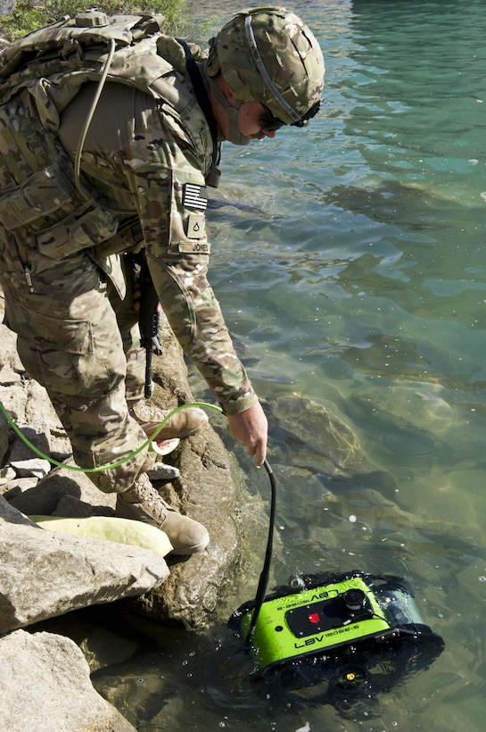 AFGHANISTAN — Spc. Matthew Jones launches a remotely controlled submersible at Dahla Dam, here, June 11, 2012. Jones is a member of 569th Engineer Dive Detachment, which deployed to Afghanistan to support the U.S. Army Corps of Engineers Afghanistan Engineer District-South, by conducting hydrographical surveys and inspections of underwater structures at Kajaki and Dahla Dams.