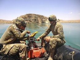 AFGHANISTAN — Spc. Matthew Tommaso (left), Staff Sgt. Bryan Crowley (center), and 1st Lt. Michael Jappe (right) conduct a hydrographic survey at Kajaki Dam. The soldiers are members of 569th Engineer Dive Detachment, which deployed to Afghanistan to support the U.S. Army Corps of Engineers Afghanistan Engineer District-South, by conducting hydrographical surveys and inspections of underwater structures at Kajaki and Dahla Dams.