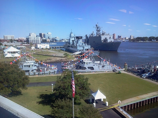 U.S. Navy vessels dock and nest at the newly refurbished Fort Norfolk wharf area during the 2012 OpSail Parade of Sail, held in early June. The Navy ships offered the public several days of open house vessel tours throughout the weeklong festivities. (U.S. Army photo/ Mark Haviland)