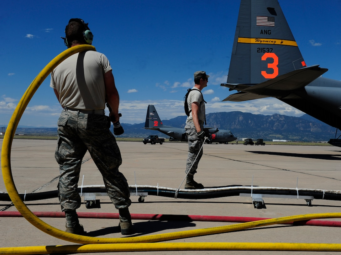 Airmen from the 153rd and 302nd Airlift Wings use the Modular Airborne Fire Fighting System-equipped C-130 Hercules aircraft to respond to the Waldo Canyon wild fire in Colorado Springs, Colo., June 27, 2012. MAFFS is a self-contained aerial firefighting system that can discharge 3,000 gallons of water or fire retardant in less than five seconds, covering an area one-quarter of a mile long by 100-feet-wide. (U.S. Air Force photo/Staff Sgt. Stephany Richards)