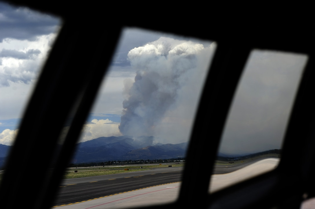 A smoke plume rises above Colorado Springsm Colo., from the Waldo Canyon Fire June 27. Air Force Reserve and Air National Guard C-130 air crews and ground personnel responded to the blaze using the Modular Airborne Fire Fighting System in conjunction with the U.S. Forest Service. MAFFS operations at based at Peterson Air Force Base, Colo. (U.S. Air Force photo/Staff Sgt. Stephany D. Richards)