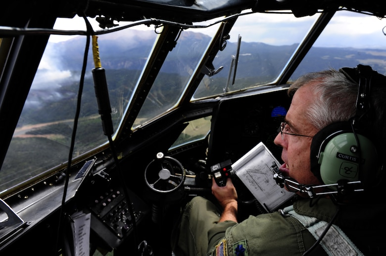 Lt. Col. Barry Curtis, a MAFFS-trained pilot with the 302 Airlift Wing, Peterson Air Force Base, Colo. flies a C-130 Hercules aircraft in support of the U.S. Forest Services fire suppression efforts in the Rocky Mountain area June 27, 2012.   (U.S. Air Force photo/ Staff Sgt. Stephany D. Richards)