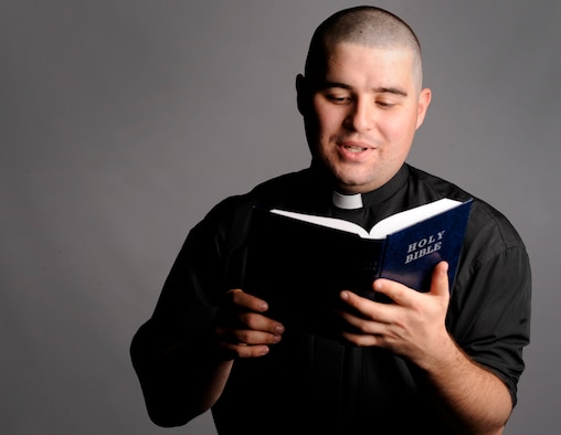 U. S. Air Force 2nd Lt. Seth DeBartolo, chaplain candidate assigned to the 9017th Air Reserve Squadron, Robins Air Force Base, Ga., reads aloud from the Bible June 26 at Mountain Home Air Force Base, Idaho. The Air Force Chaplain Candidate Program is a special opportunity for seminary students from all faiths to experience ministering to active-duty Air Force personnel. (U. S. Air Force photo/Senior Airman Benjamin Sutton/Released)