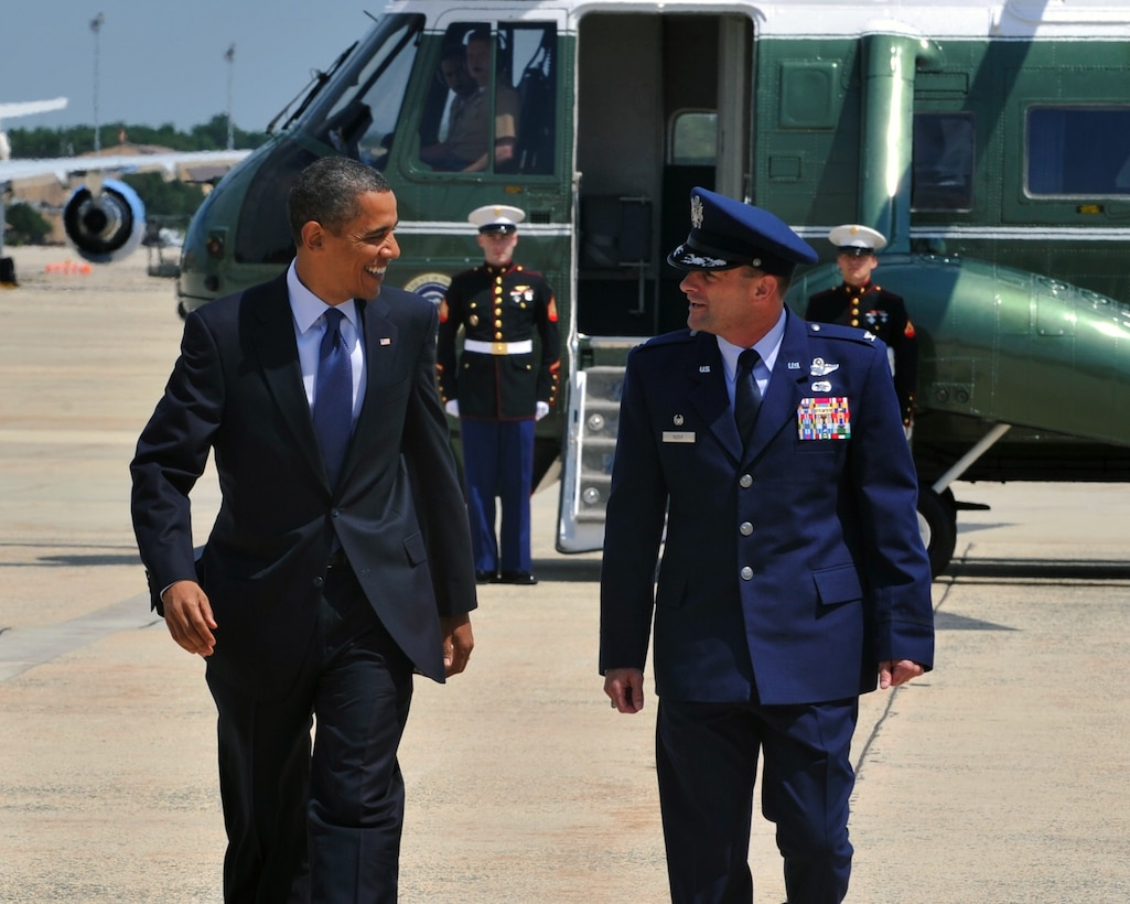 Walking side by side, President Barack Obama and Col. Ken Rizer, 11th Wing/Joint Base Andrews commander, chat on the flightline about the latest football standings. After serving more than 25 years in activeduty military service Rizer will retire in a ceremony here July 6.