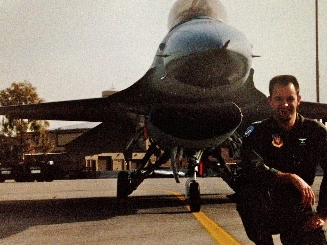 Next to his F-16 Fighting Falcon, Col. Ken Rizer, 11th Wing/Joint Base Andrews commander, poses for a photo. Throughout his career, Rizer gained more than 2,700 flight hours and distinguished himself as an Air Force pilot with various decorations such as: the Aerial Achievement Medal, Air Medal with two oak leaf clusters, Air Force Commendation Medal and the Air Force Achievement Medal with one oak leaf cluster. (Courtesy photo)