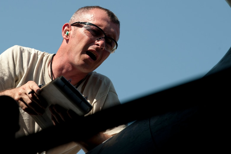 U.S. Air Force Master Sgt. James Hudson, 707th Maintenance Squadron weapons load crew team chief, directs the loading operation of an Air Launched Cruise Missile package on a B-52H Stratofortress, Barksdale Air Force Base, La., June 15, 2012. Hudson and his crew became the first in the Air Force Reserve Command certified to load nuclear weapons on a B-52. (U.S. Air Force photo by Master Sgt. Greg Steele/Released)