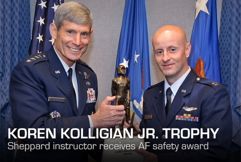 Air Force Chief of Staff Gen. Norton Schwartz presents the Koren Kolligian Jr. Trophy to 2011 recipient Capt. Frank Baumann during a Pentagon ceremony June 27, 2012.  Baumann is an instructor pilot stationed at Sheppard Air Force Base, Texas.  The trophy, established in 1958, is the only Air Force individual safety award personally presented by the Air Force Chief of Staff.   (U.S. Air Force photo/Michael J. Pausic)