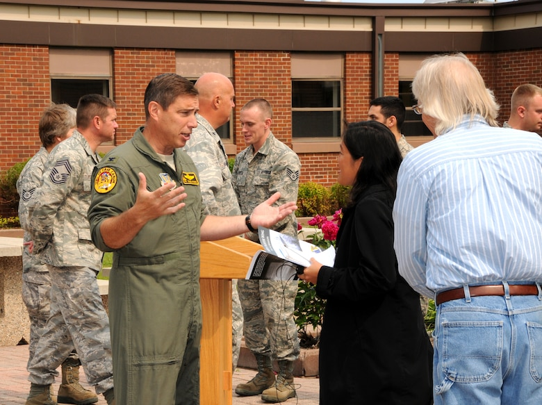 148th Fighter Wing Commander Col. Frank Stokes speaks with Renee Passal during a press conference at the 148th Fighter Wing June 28, 2012.  Stokes spoke about the upcoming deployment to Kandahar Air Field, Afghanistan, where the 148th Fighter Wing is scheduled to put their new Block 50 F-16s to the test. (National Guard photo by Master Sgt. Ralph J. Kapustka.)