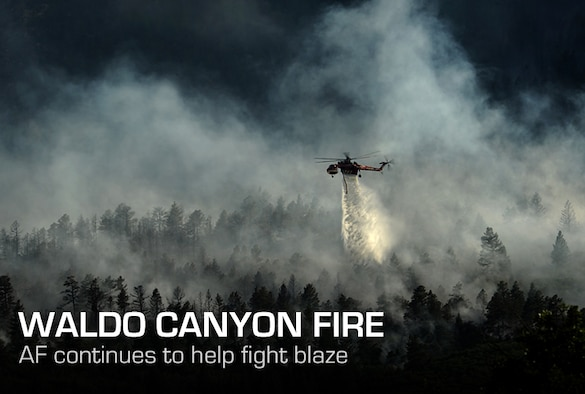 A helicopter drops water on the fire as firefighters continued to battle the blaze that burned into the evening hours in Waldo Canyon on the U.S. Air Force Academy June 27, 2012. The fires, which have burned more than 15,000 acres, began spreading to the southwestern corner of the Academy in the early morning, causing base officials to evacuate residents. Officials estimated that the fire had spread to about 10 acres of land belonging to the Academy. U.S. Air Force Photo by: Master Sgt. Jeremy Lock)