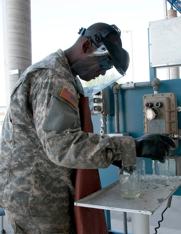 Army Reserve Sgt. Robert Childs takes a visual sample of JP8 fuel to check for sediments at the 162nd Fighter Wing at Tucson International Airport, June 21. Soldiers delivered fuel to 73 F-16 Fighting Falcons here for two weeks as part of their annual Quartermaster Liquid Logistics Exercise. (U.S. Air Force photo/Master Sgt. Dave Neve)