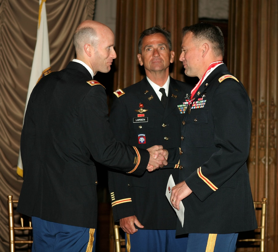 PHILADELPHIA, Pa. — Lt. Col. Chris Becking, incoming U.S. Army Corps of Engineers Philadelphia District Commander (left),thanks outgoing commander Lt. Col. Philip Secrist (right), during the Change of Command ceremony  here, June 26, 2012. Christopher J. Larsen, USACE North Atlantic Division Commander (center), presided over the ceremony.