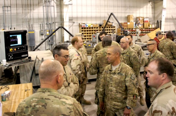 BAGRAM AIRFIELD, Afghanistan — U.S. Army Research, Development and Engineering Command Field Assistance in Science and Technology-Center, or RFAST-C, engineers and technicians discuss prototype integration facility capabilities with senior noncommissioned officers from the 18th Engineer Brigade.