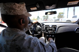 Bluetooth devices are permitted when operating a vehicle on Marine Corps Base Camp Pendleton. These devices allow the drivers' hands to be free to maintain positive control of the steering wheel and keep their eyes on the road. (Photo illustration)