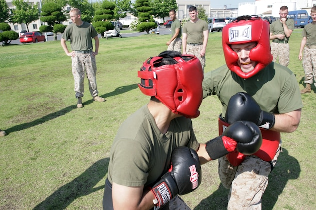 Pfc. Joshua A. Daehnke (right) and Lance Cpl. Alfredo Robles Jr., Marine Aircraft Group 12 supply administration and operations specialists, duke it out during the MAG-12 fight night here June 29, 2012. Fight night built camaraderie while giving the Marines an opportunity to train and maintain their combat mind-set. Marines were able to choose their opponents, whether to settle a squall or just to battle in a safe, friendly, competitive environment.