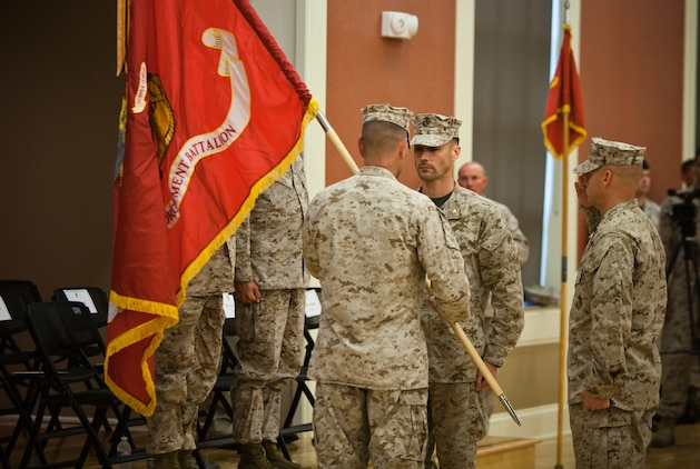 Major Eric Young, commanding officer of 2nd Law Enforcement Battalion, is presented with the battalion's battle colors by Col. Michael M. Sweeney, commanding officer of II Marine Expeditionary Force Headquarters Group, during 2nd LEB's activation ceremony at Marine Corps Base Camp Lejeune, N.C., June 26. The battalion will be a force multiplier to the operating forces by assisting in a variety of missions that include law enforcement, route regulation, humanitarian assistance, nonlethal weapons training and military working dog employment.