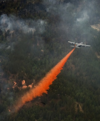 A C-130 Hercules equipped with a Modular Airborne Fire Fighting System supports fire suppression efforts near Colorado Springs, Colo., June 27, 2012. Four MAFFS-equipped aircraft, two from the Wyoming Air National Guard's 153rd Airlift Wing and two from the Air Force Reserve Command's 302nd Airlift Wing, flew in support of the U.S. Forest Service to fight fires in Colorado. (U.S. Air Force photo/ Staff Sgt. Stephany D. Richards)