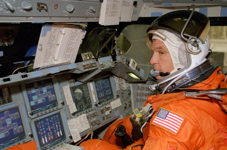 Astronaut Michael J. Bloomfield, STS-97 pilot, mans the pilot's station of a Crew Compartment Trainer in July 1999 during a training exercise at Johnson Space Center's Systems Integration Facility. (NASA photo)