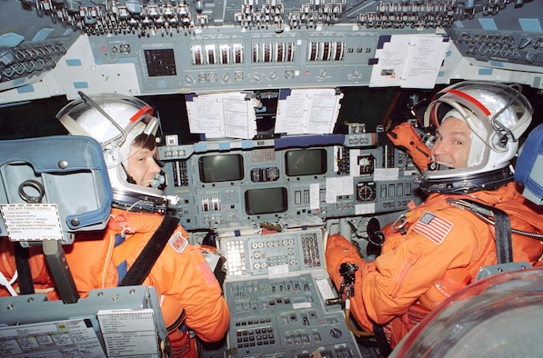 Astronauts Donald R. McMonagle (left) and Curtis L. Brown man the commander's and pilot's stations, respectively, during a rehearsal of ascent and entry phases of their scheduled November 1994 flight aboard Space Shuttle Atlantis. Three other NASA astronauts and a European mission specialist joined the two for this training exercise in the Crew Compartment Trainer at Johnson Space Center's Shuttle Mockup and Integration Laboratory in June 1994 and will join them aboard Atlantis in November. The flight is manifest to support the Atmospheric Laboratory for Applications and Science (ATLAS-3) mission. (NASA photo)