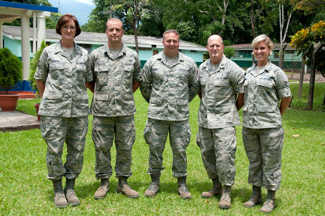 Master Sgt. Sandy Roberts (left), Tech. Sgt. Shawn Theberge, Tech. Sgt. Michael Dame, Capt. Rex Rubin, and Senior Airman Alexa Shimmel, all from the 157th Medical Group New England CERFP team, pose for a group photo outside the training complex on base June 26, 2012. The five medical personnel from the New Hampshire Air National Guard traveled here to participate in a Chemical Biological Radiological Nuclear High Yield Explosive Enhanced Response Force Package (CERFP) exchange with local authorities. (N.H. National Guard photo by Tech. Sgt. Mark Wyatt/RELEASED)