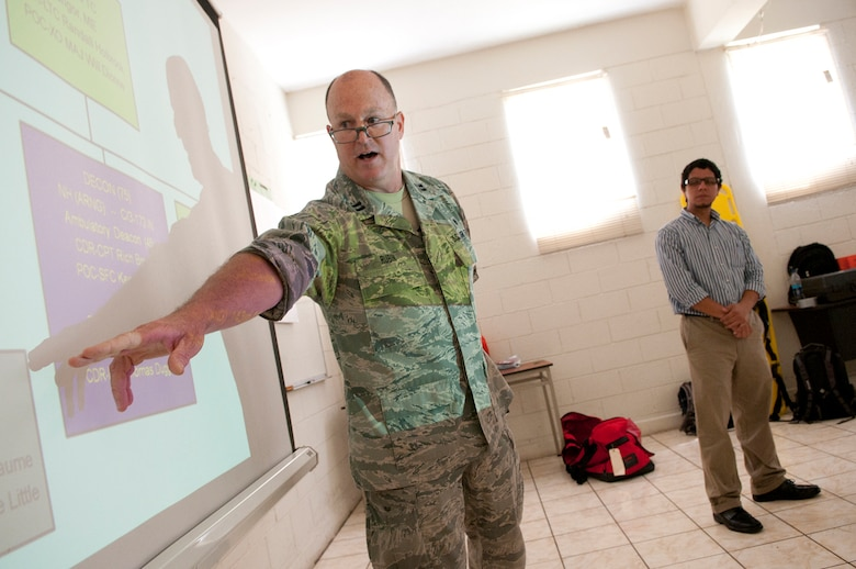U.S. Air Force Capt. Rex Rubin, a search and extraction operations manager, opens a three-day training exchage with members of the Salvadoran Army and other local civil authorities June 26, 2012. Five medical personnel from the New Hampshire Air National Guard traveled here to participate in a Chemical Biological Radiological Nuclear High Yield Explosive Enhanced Response Force Package (CERFP) exchange with local authorities. (N.H. National Guard photo by Tech. Sgt. Mark Wyatt/RELEASED)