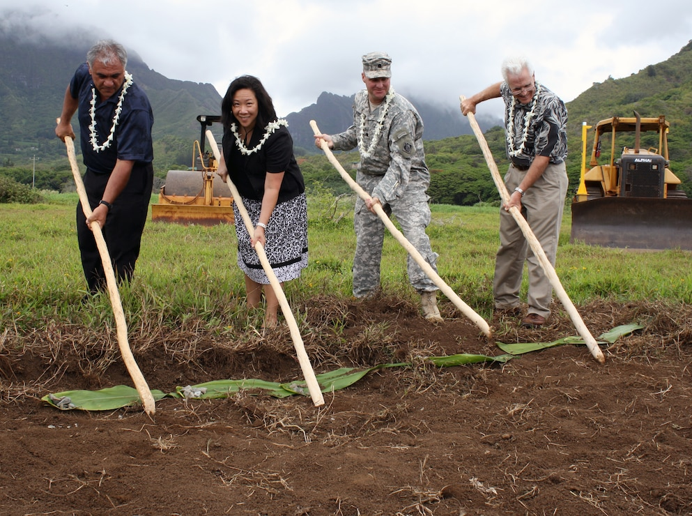 KAILUA, Hawaii — The Department of Land and Natural Resources and the U.S. Army Corps of Engineers broke ground  June 28, 2012 on the Kawainui Marsh Environmental Restoration Project in Kailua, O'ahu. The project will increase populations of endangered waterfowl, create scenic open space, reduce upland runoff to coastal reefs and remove invasive weeds from the marsh. Pictured from left to right breaking ground are William J. Aila, Jr., DLNR chairperson, Staff Member Jennifer Wooten representing Sen. Daniel K. Inouye, Honolulu District Commnder Lt. Col. Douglas B. Guttormsen and Paul Conry, Division of Forestry and Wildlife administrator.